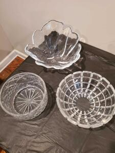 Grouping of three large glass bowls.