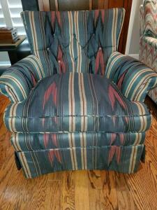 Flame stitch upholstered arm chair with tufted back.