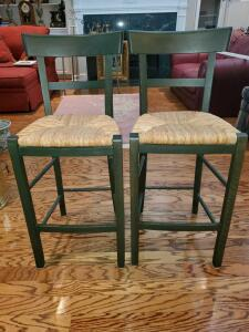 "Pair of green bar stools with a rush seat. 16x15x37"" tall. Seat height 25"""