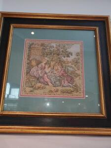 Framed tapestry of A man, two women, and a lamb. 9x21""