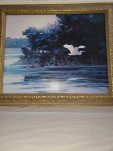 Painting of a heron flying from a lake. Artists signed. 36 x 30""