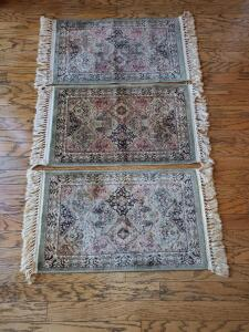 "Five small rugs. Each one is 33 x 19""."