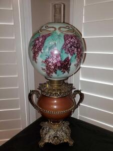 Hand-painted antique gone with the wind style oil lamp that has been converted to electric.