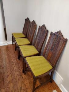 Four antique cane back dining chairs. One needs slight repair to cane.