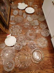 Very large grouping of glass ware. Platters, bowls, egg trays. Everything you need for the party except the guests.