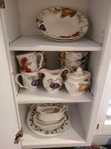 Cabinet of dishware from brands including limoges, charter club, and Johnson Brothers.