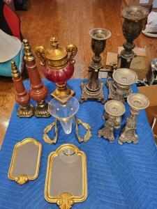 Grouping of decorative items including candle stands, mirrors, and more.