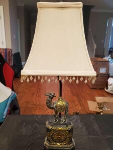 "lamp with a camel motif and beaded linen shade. 23"" tall."