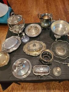 Collection of silver plate serving items.