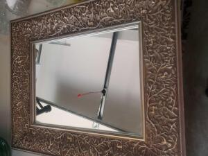 A solid framed mirror, 23 x 19