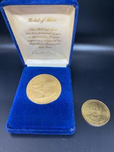 Medal of merit from Ronald Regan commemorative coin and George H Bush collection coin