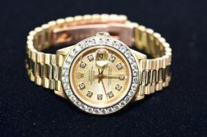 Lady's Diamond and 18 Karat Gold Rolex Watch
