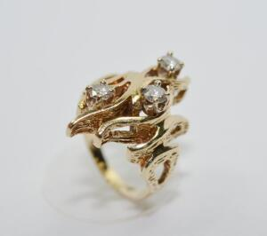 Lady's 14 Karat Yellow Gold Flame (free-form) Diamond Ring.
