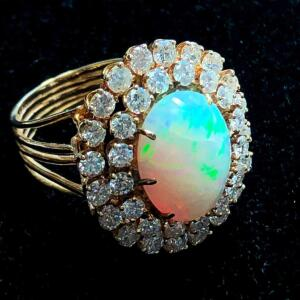 Lady's 5 Carat Opal and Diamond Ring.