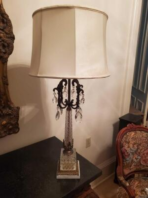 A gorgeous crystal lamp, accented in brass with a marble base
