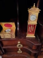 Clocks located in lower portion of secretary in the parlor. - 3