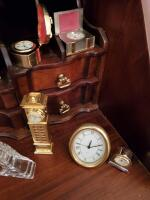Clocks located in lower portion of secretary in the parlor. - 4