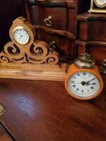 Clocks located in lower portion of secretary in the parlor. - 6