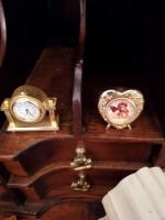 Clocks located in lower portion of secretary in the parlor. - 8