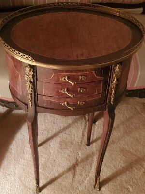 "A 3-drawer antique nightstands adorned with brass, it's 22"" tall, the top is oval and 17 x 13"