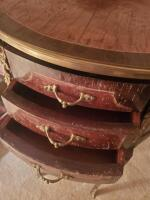 "A 3-drawer antique nightstands adorned with brass, it's 22"" tall, the top is oval and 17 x 13 - 3"