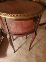 "A 3-drawer antique nightstands adorned with brass, it's 22"" tall, the top is oval and 17 x 13 - 8"
