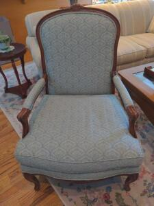 Upholstered side chair with solid wood accents