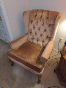 Tan velour wingback chair