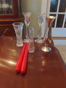 Collection of candlesticks and bud vases