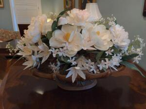 Beautiful silk floral arrangement featuring large magnolias and chrysanthemums
