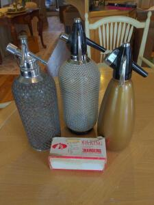 Collection of vintage seltzer bottles plus accessories