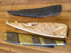Two Leather and One Canvas Gun Case