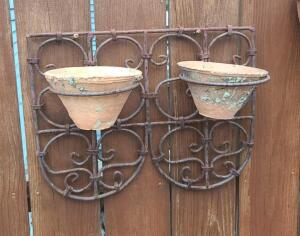 "Iron wall hanger w 2 terra cotta planters 12"" h x 18"" w"