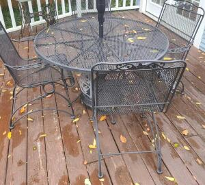 "Wrought iron table 56"" and 4 chairs w cushions does not include umbrella and stand"