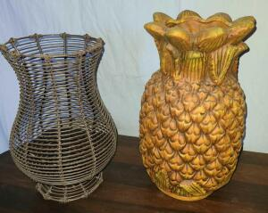 "2 VASES. METAL BASKET 11"" TALL X 9"" AT WIDEST. PINEAPPLE VASE IS CERAMIC 13"" TALL X 8"" AT WIDEST."