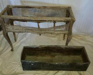"ANTIQUE WICKER PLANTER W/ METAL INSERT. NEEDS REPAIR. 26.25"" TALL X 34.5"" WIDE X 11.5"" DEEP."