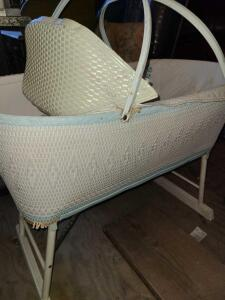 "ANTIQUE BABY BASSINET WICKER ON ROLLERS W/ FLIP SHADE. 27"" TALL X 33"" LONG X 19.5"" WIDE."