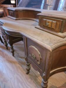 "ANTIQUE VANITY W/ MIRROR. 4 DRAWERS 24"" TO LOWER SURFACE. 50"" WIDE X 19.5"" AT DEEPEST. ON CASTERS."