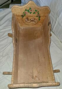 "ANTIQUE WOODEN BABY CRADLE ROCKER. 17"" TALL X 24"" LONG X 12"" WIDE."