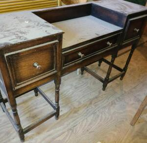 ANTIQUE WOODEN 3 DRAWER DESK. COULD BE USED AS A VANITY. DUSTY AND SOME WOOD SPLITTING FROM AGE.