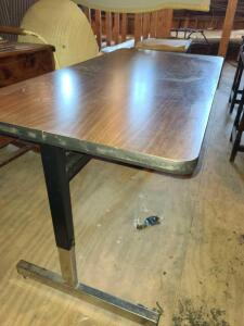 "MODERN ADJUSTABLE HEIGHT TABLE. SHOWN AT 28"" TALL X 48"" WIDE X 24"" DEEP."