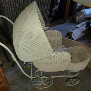 "ANTIQUE BABY CARRIAGE. WICKER W/ IRON AND RUBBER WHEELS. AWESOME PICTURE PROP. 40"" TALL X 40"" LONG"