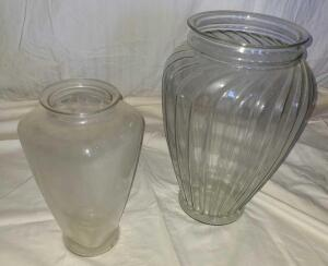 "2 LARGE GLASS VASES. 13"" TALL X 7"" WIDE AND 16.5"" TALL X 11"" WIDE. DUSTY."