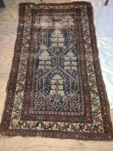 "ANTIQUE AREA RUG. 68"" X 38"". SHOWS WEAR BUT ON ONE END ONLY."