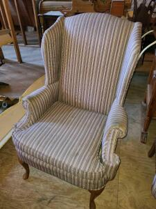 "STRIPPED WING BACK CHAIR. GREAT SHAPE. BACK 45"" X 30"" WIDE X 31"" DEEP. ARMS NEED CLEANING."