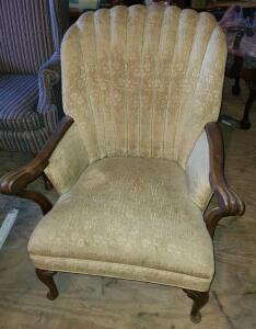 ANTIQUE ARM CHAIR. SHOWS SOME SIGNS OF AGE LIKE A SPLIT IN THE BACK. SOLID. RECOVER IT AND
