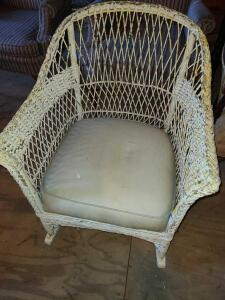 "ANTIQUE WICKER ROCKER W/ THICK PADDED CUSHION. BACK 32"" TALL X 27.5"" WIDE X 35"" DEEP. THICK WICKER."