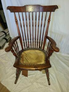 "ANTIQUE WOODEN ROCKING CHAIR. NEEDS NEW SEAT BOTTOM. SOLID STURDY STRUCTURE. BACK 36.5"" TALL X"