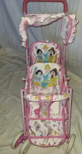 "DISNEY PRINCESSES DOUBLE BABY DOLL STROLLER. 25"" TALL X 10.5"" WIDE. EXCELLENT CONDITION."
