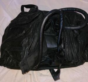 "2 BLACK LEATHER DUFFLE BAGS 20"" X 12"" X 12"". WILL FIT IN PLANE OVERHEAD. SHOULDER STRAP OR CARRY"